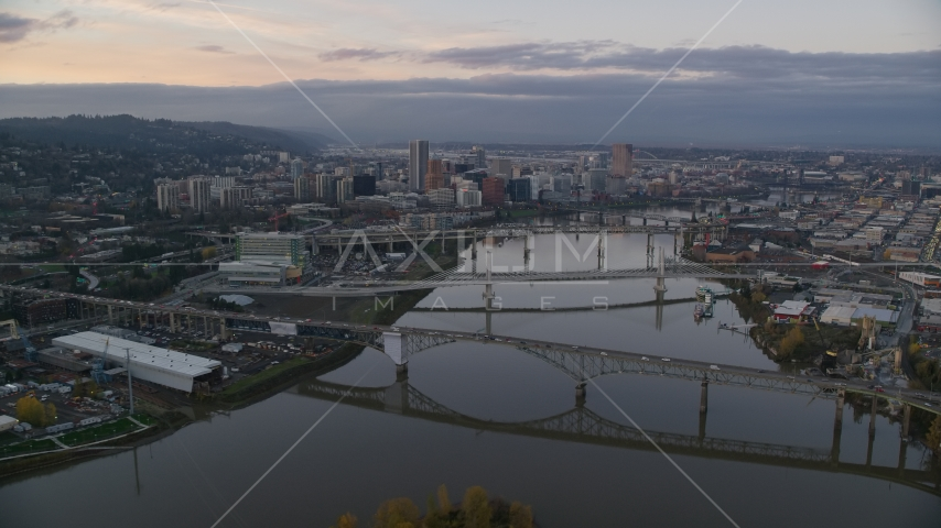 Downtown Portland and the Willamette River at sunset, seen from the Ross Island Bridge Aerial Stock Photos | AX155_170.0000292F