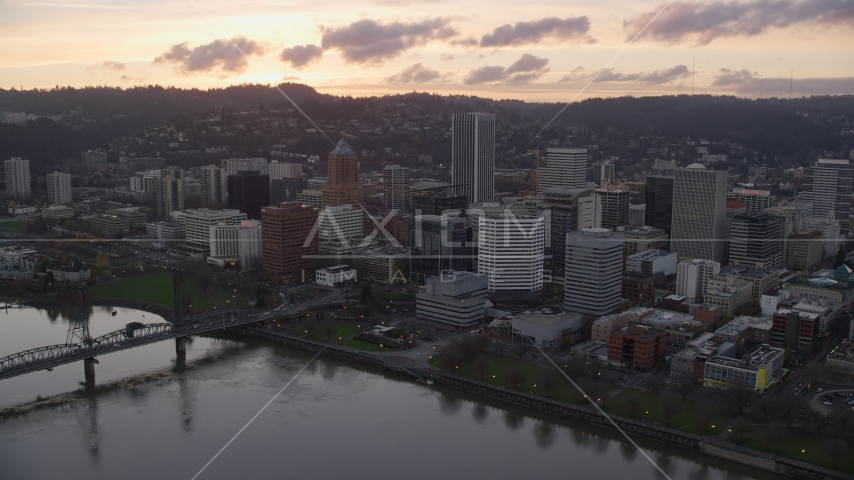 The Hawthorne Bridge, the waterfront park and Downtown Portland at sunset in Oregon Aerial Stock Photo AX155_174.0000098F | Axiom Images