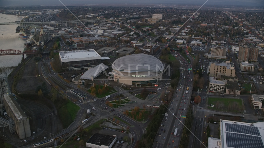 Light traffic on I-5 to Veterans Memorial Colosseum and Moda Center in Lloyd District, Portland, Oregon, sunset Aerial Stock Photo AX155_175.0000250F | Axiom Images