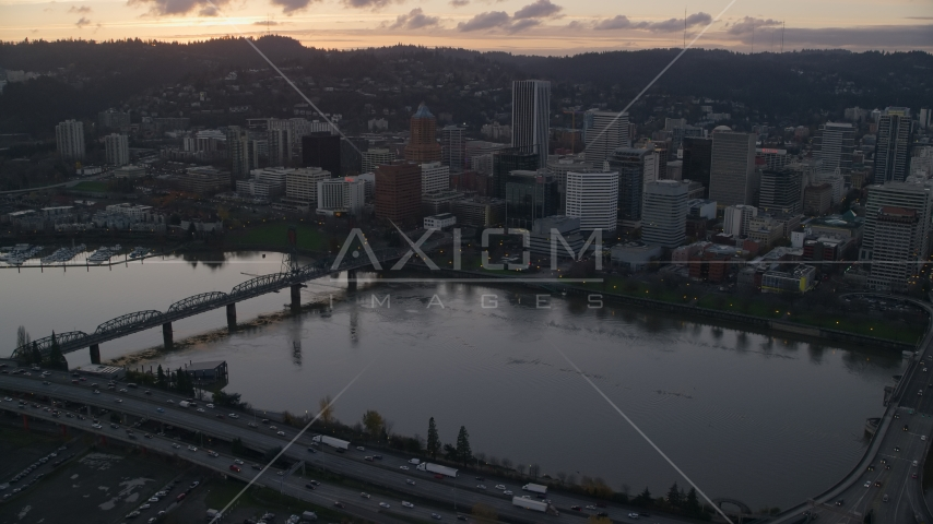 The Willamette River and Downtown Portland at sunset in Oregon Aerial Stock Photos | AX155_178.0000242F