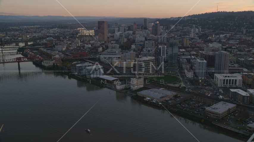 Skyscrapers and buildings along the river at sunset, Downtown Portland, Oregon Aerial Stock Photos | AX155_183.0000300F