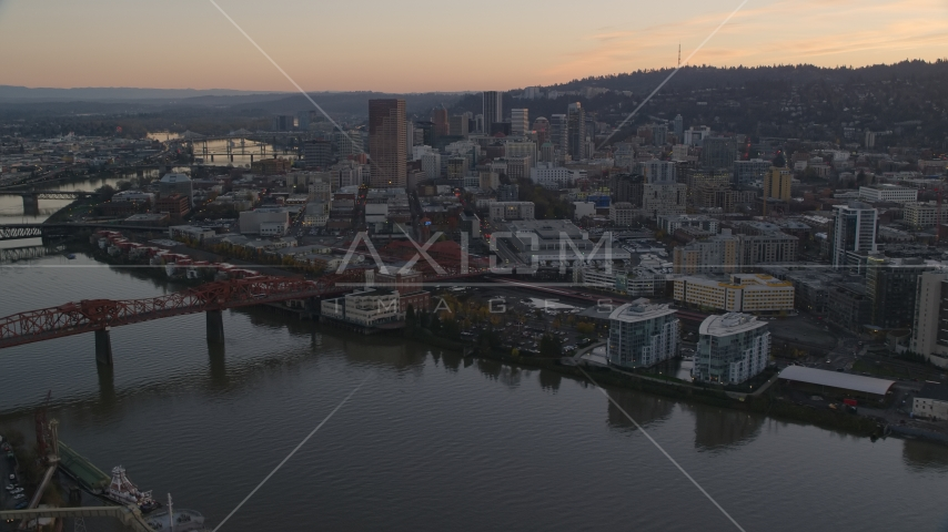 Downtown Portland skyscrapers and Union Station seen from near the Broadway Bridge at sunset in Oregon Aerial Stock Photos | AX155_184.0000216F