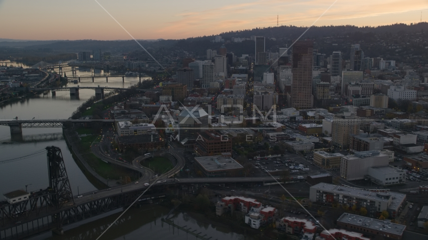 Downtown Portland skyscrapers and Union Station seen from over the Broadway Bridge at sunset in Oregon Aerial Stock Photo AX155_185.0000359F | Axiom Images