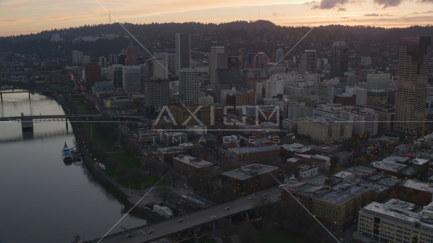 Downtown Portland skyscrapers seen from Willamette River at sunset in Oregon Aerial Stock Photos | AX155_186.0000351F