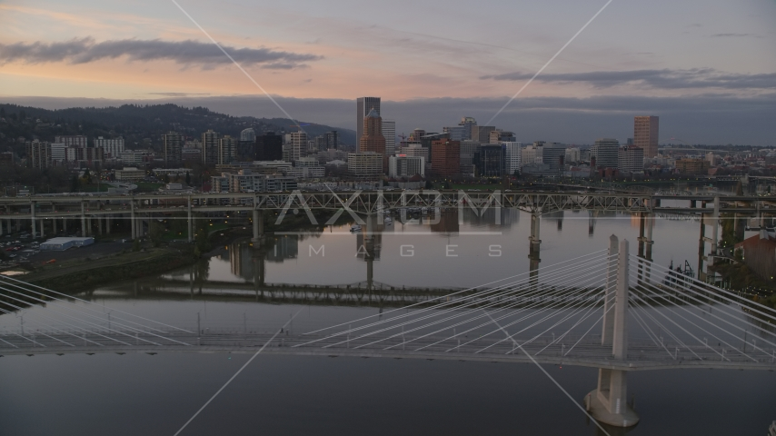 Downtown Portland skyline and Marquam Bridge seen from Tilikum Crossing at sunset, Oregon Aerial Stock Photo AX155_191.0000000F | Axiom Images