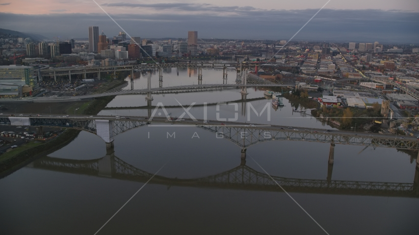 Ross Island Bridge and Willamette River bridges at sunset, reveal Downtown Portland, Oregon Aerial Stock Photo AX155_197.0000349F | Axiom Images