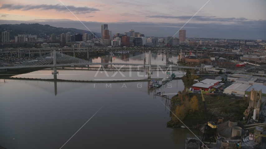 Tilikum Crossing, Marquam Bridge, and downtown skyline at sunset, Downtown Portland, Oregon Aerial Stock Photos | AX155_199.0000000F