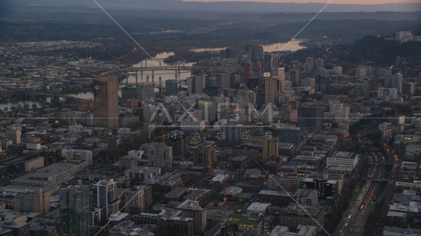 Downtown Portland cityscape by the Willamette River at sunset, Oregon Aerial Stock Photo AX155_218.0000000F | Axiom Images