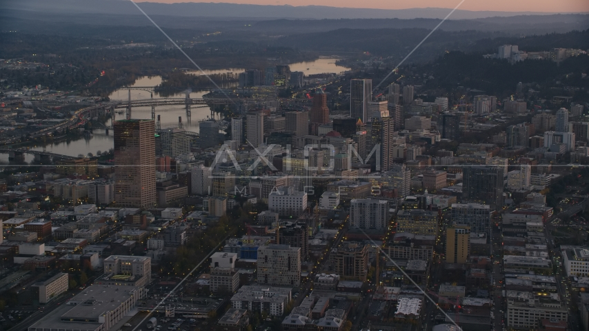 Downtown Portland cityscape by the Willamette River at sunset, Oregon Aerial Stock Photo AX155_219.0000000F | Axiom Images