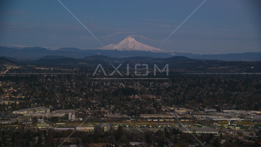 Mount Hood at sunset, seen from a train yard and neighborhoods in Southeast Portland, Oregon Aerial Stock Photo AX155_248.0000000F | Axiom Images
