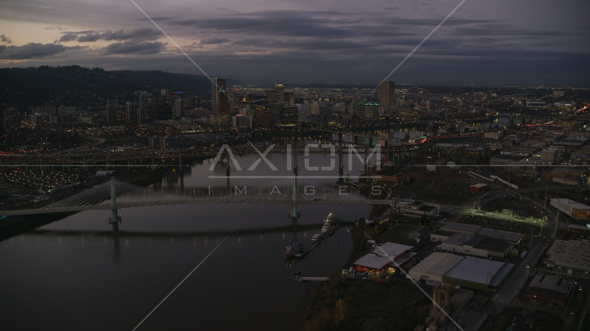 Skyscrapers and bridges over the Willamette River at sunset, Downtown Portland, Oregon Aerial Stock Photo AX155_249.0000272F | Axiom Images