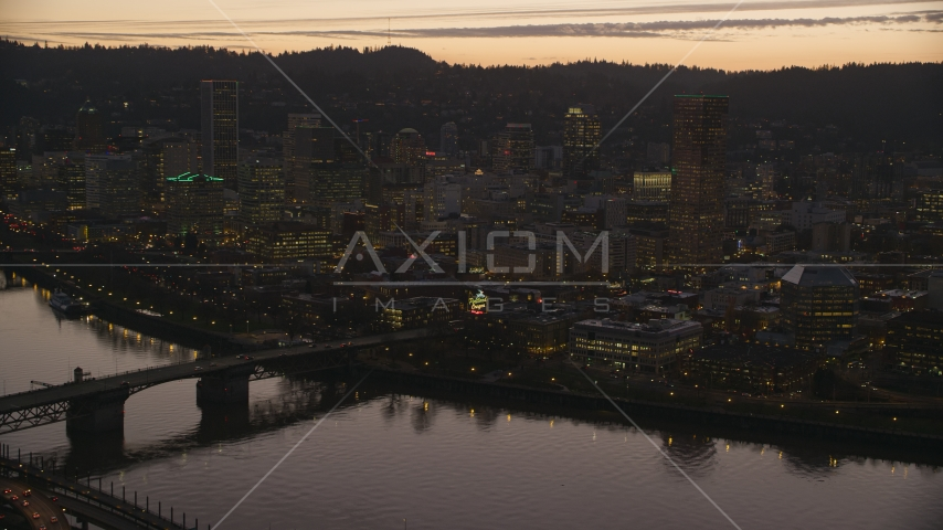 The Burnside Bridge over the Willamette River, White Stag Sign, US Bancorp Tower at sunset, Downtown Portland, Oregon Aerial Stock Photo AX155_255.0000321F | Axiom Images