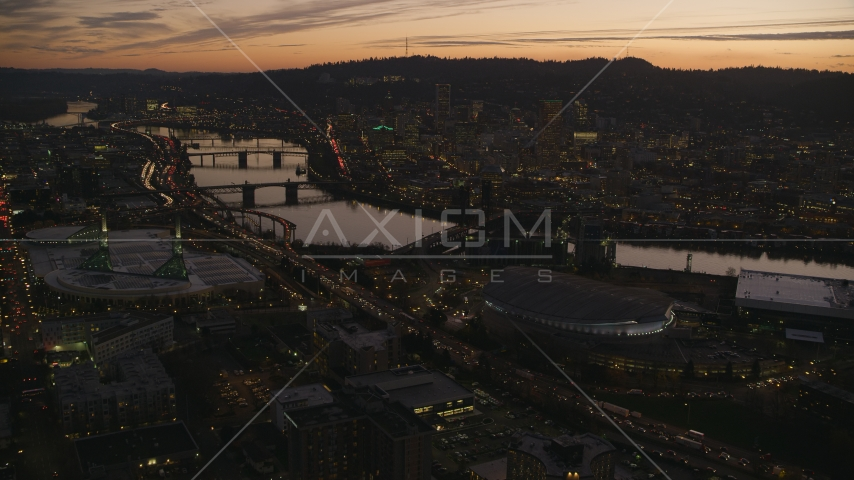 Moda Center, Willamette River, and downtown skyscrapers at sunset, Downtown Portland, Oregon Aerial Stock Photo AX155_260.0000149F | Axiom Images