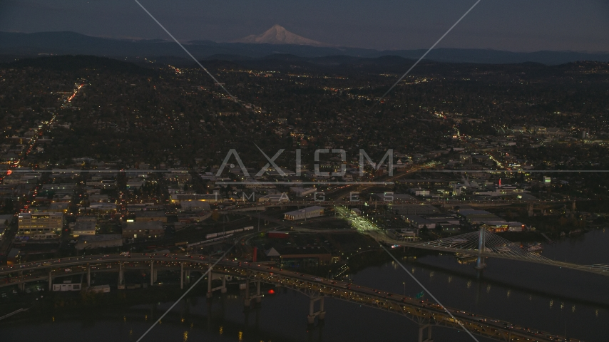 Mount Hood in the far distance, and warehouse buildings near the Willamette River, Southeast Portland, Oregon, sunset Aerial Stock Photos | AX155_266.0000105F