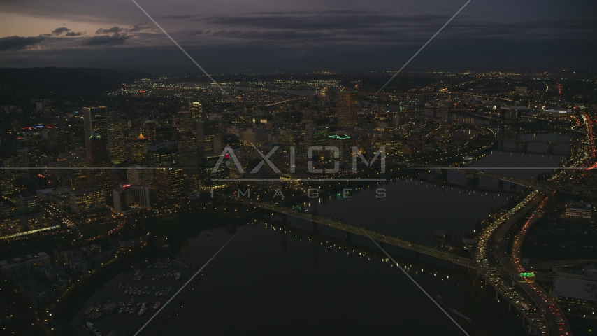Downtown Portland's cityscape beside the Willamette River at sunset, Oregon Aerial Stock Photos | AX155_268.0000248F