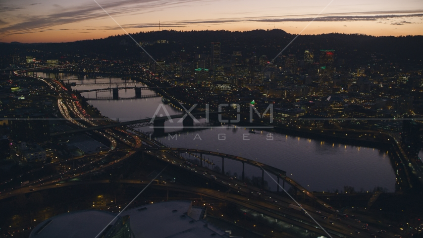 Willamette River, bridges and Downtown Portland, Oregon at sunset Aerial Stock Photo AX155_277.0000100F | Axiom Images
