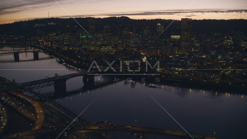 Freeway interchange, Willamette River, Burnside Bridge, and Downtown Portland, Oregon at sunset Aerial Stock Photos | AX155_278.0000359F