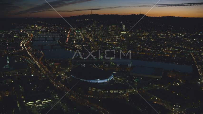 Downtown Portland and Willamette River at night seen from Moda Center in Oregon Aerial Stock Photos | AX155_308.0000296F