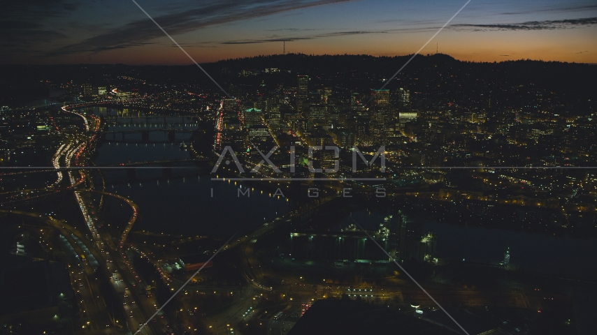 A view of Downtown Portland, Oregon, at night across the Willamette River Aerial Stock Photos | AX155_314.0000000F