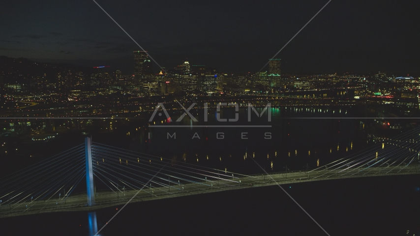 Tilikum Crossing and Marquam Bridge, with Downtown Portland skyline in the distance, Oregon, night Aerial Stock Photo AX155_325.0000188F | Axiom Images