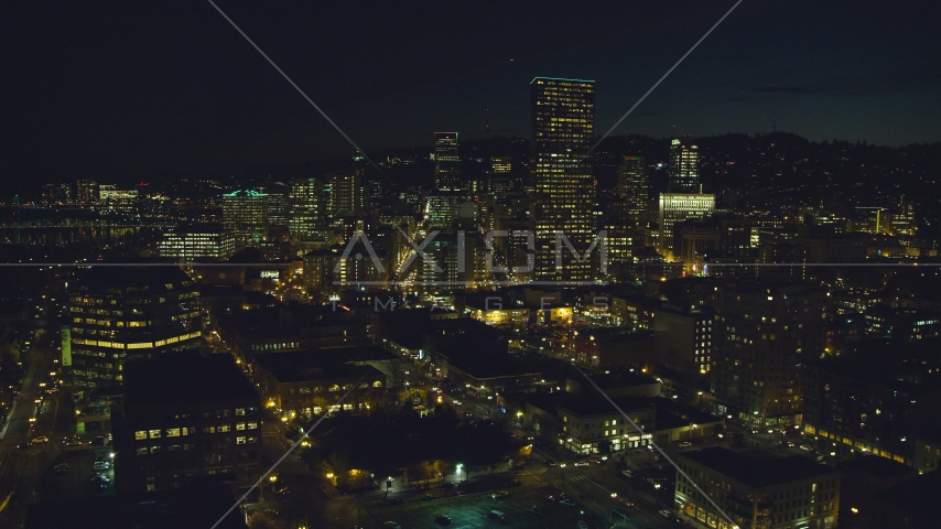 US Bancorp Tower and skyscrapers by the Willamette River at nighttime, Downtown Portland, Oregon Aerial Stock Photos | AX155_366.0000310F