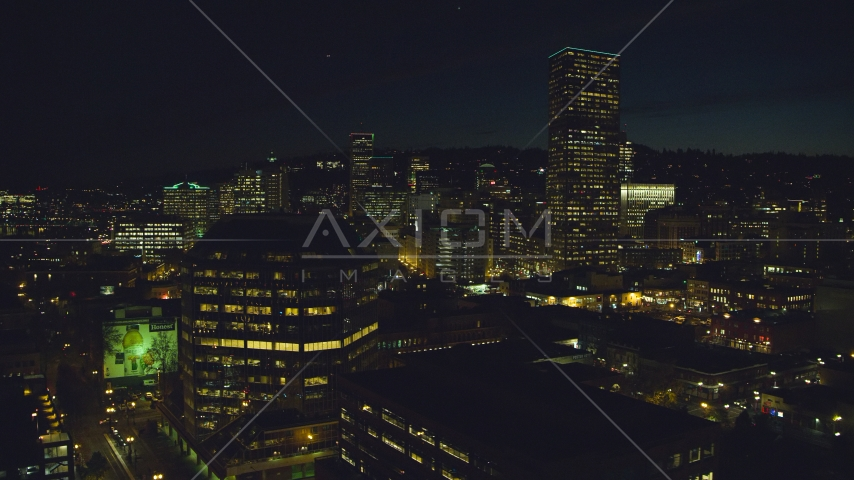 One Pacific Square, with US Bancorp Tower and high-rises in the background at night, Downtown Portland, Oregon Aerial Stock Photo AX155_368.0000040F | Axiom Images