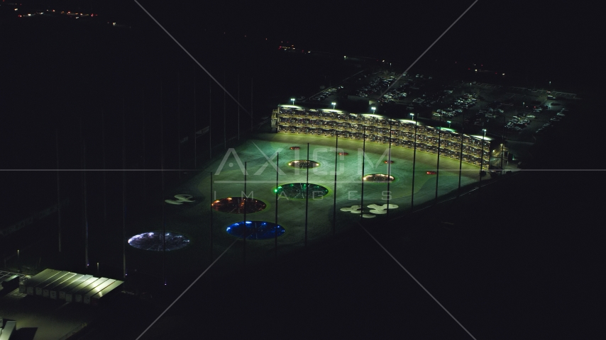 A warehouse building and a Topgolf course in Hillsboro, Oregon at night Aerial Stock Photo AX155_475.0000259F | Axiom Images