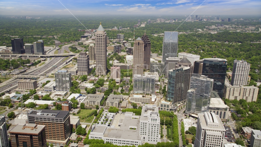 Office buildings with skyscrapers in the distance, Midtown Atlanta, Georgia Aerial Stock Photos | AX36_011.0000208F
