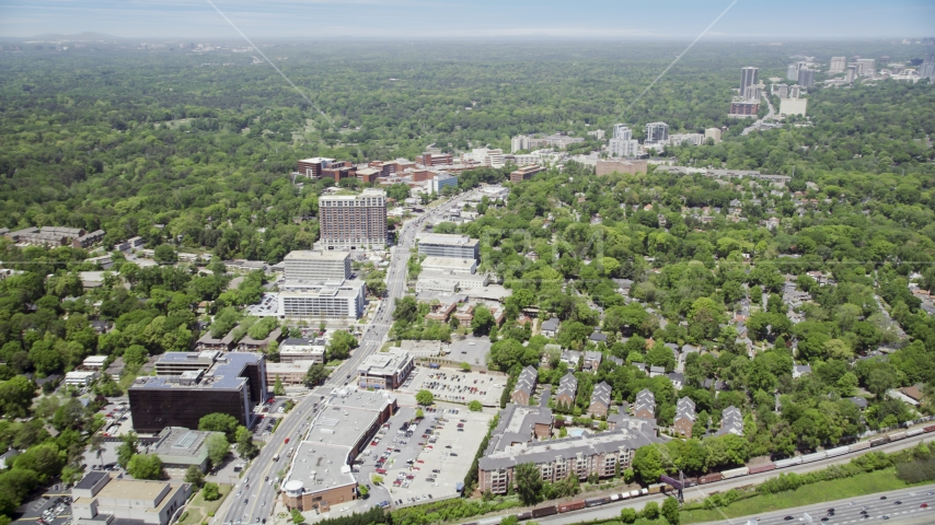 Office buildings and wooded areas, skyscrapers in the distance, Buckhead, Georgia Aerial Stock Photos | AX36_046.0000119F