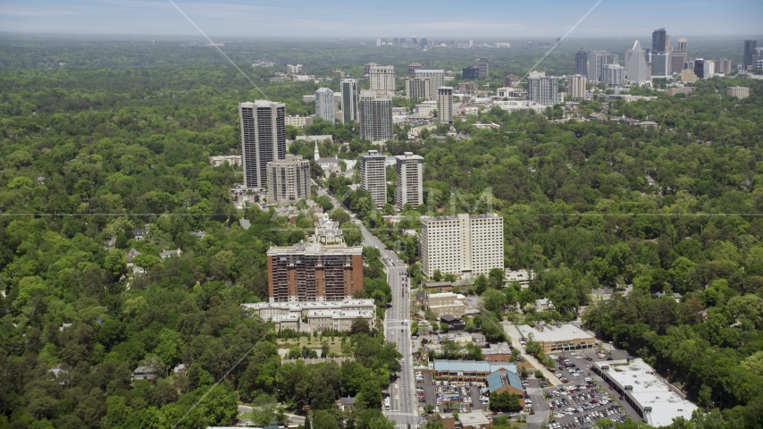 Peachtree Road through office buildings among wooded area, Bulkhead, Georgia Aerial Stock Photos | AX36_049.0000120F