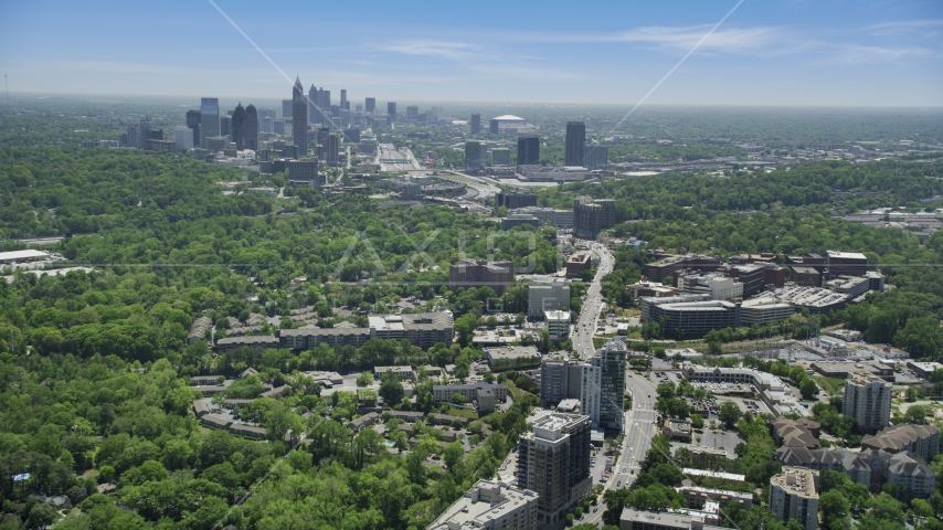 High above office buildings looking toward Midtown Atlanta skyline; Buckhead, Georgia Aerial Stock Photos | AX36_082.0000067F