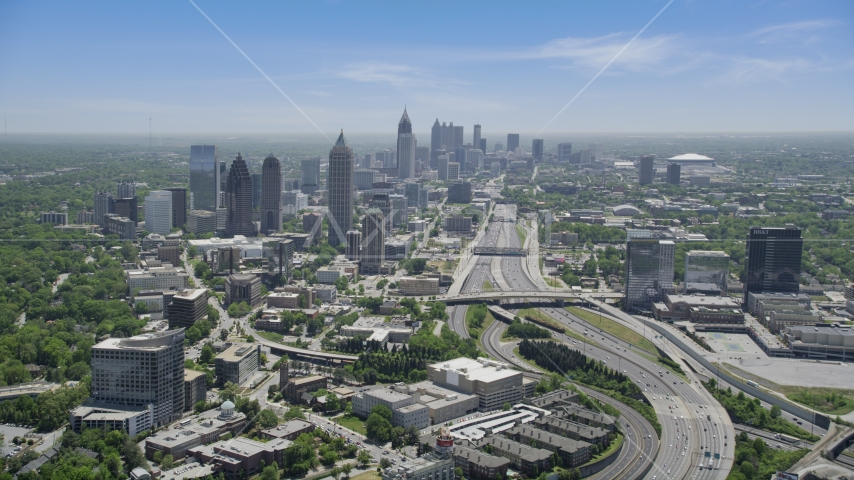 Downtown Connector near Midtown Atlanta skyscrapers, Georgia Aerial Stock Photo AX36_085.0000068F | Axiom Images