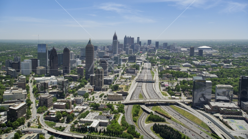 Downtown Connector near Midtown Atlanta skyscrapers, Georgia Aerial Stock Photo AX36_086.0000057F | Axiom Images