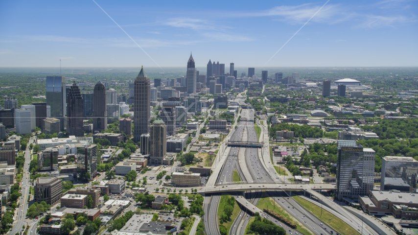 Downtown Connector toward Midtown Atlanta skyscrapers, hazy, Georgia Aerial Stock Photos | AX36_086.0000141F