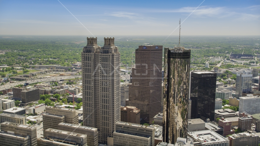 Skyscrapers towering over smaller office buildings, Downtown Atlanta, Georgia Aerial Stock Photo AX36_095.0000016F | Axiom Images