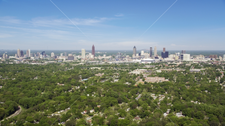 Midtown and Downtown Atlanta seen from above the trees in West Atlanta, Georgia Aerial Stock Photos | AX37_006.0000258F