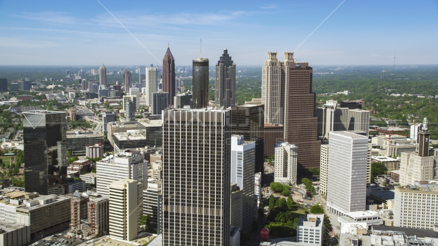 Downtown skyscrapers and office buildings under blue skies, Atlanta, Georgia Aerial Stock Photo AX37_013.0000093F | Axiom Images