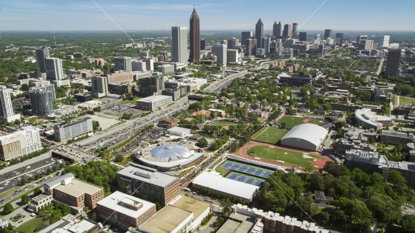 Georgia Institute of Technology with distant Midtown Atlanta skyscrapers, Georgia Aerial Stock Photo AX37_034.0000299F | Axiom Images
