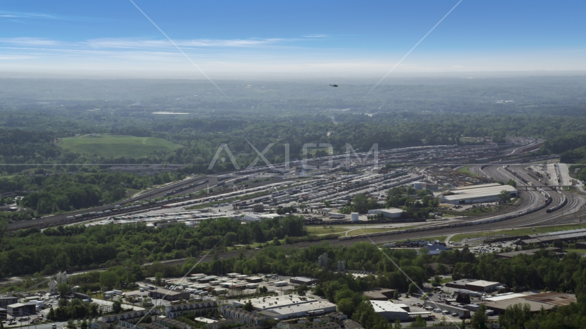 Train yard surrounded by green trees, Atlanta, Georgia Aerial Stock Photos | AX37_085.0000025F