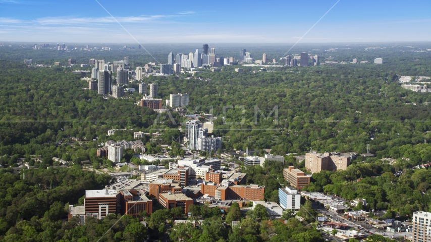 Wide shot of skyscrapers and high-rises surrounded by forests, Buckhead, Georgia Aerial Stock Photos | AX38_007.0000035F