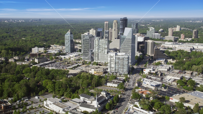 Skyscrapers overlooking forests, Buckhead, Georgia Aerial Stock Photos | AX38_012.0000306F