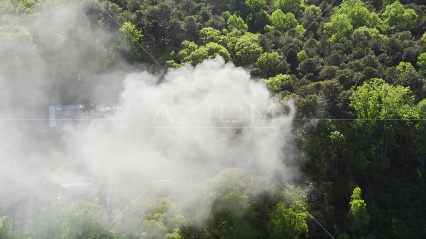 Thick smoke rising from a burning home, West Atlanta, Georgia Aerial Stock Photos | AX38_038.0000393F