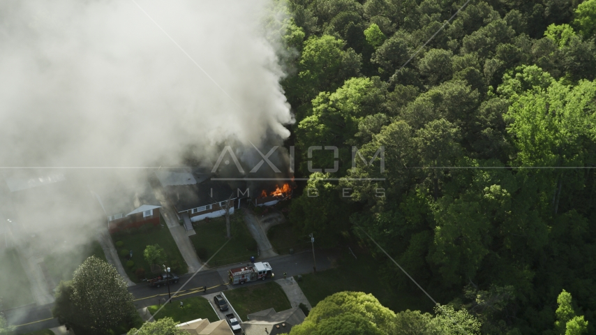 Rising smoke from a burning house, West Atlanta, Georgia Aerial Stock Photos | AX38_045.0000458F