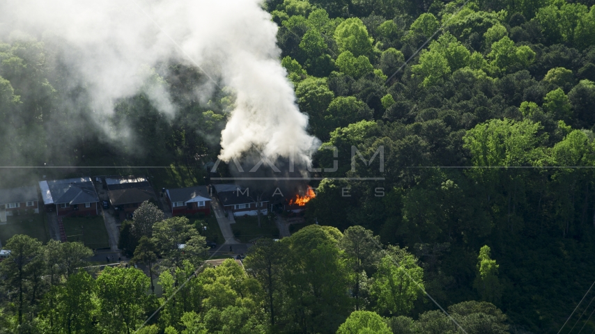 Smoke and flames rising from a burning home, West Atlanta, Georgia Aerial Stock Photos | AX38_052.0000129F