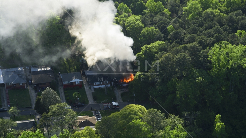 Smoke and flames from a burning home, West Atlanta, Georgia Aerial Stock Photos | AX38_052.0000276F
