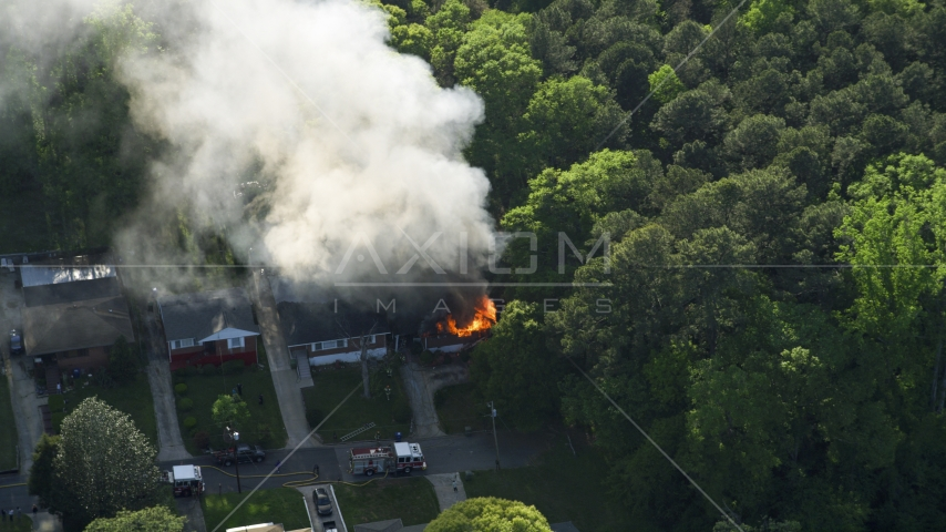 Smoke and flames from a burning home, West Atlanta, Georgia Aerial Stock Photos | AX38_052.0000382F