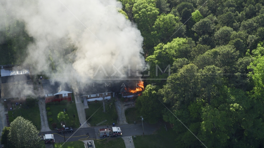 Looking down on a burning home with smoke rising, West Atlanta, Georgia Aerial Stock Photo AX38_053.0000016F | Axiom Images