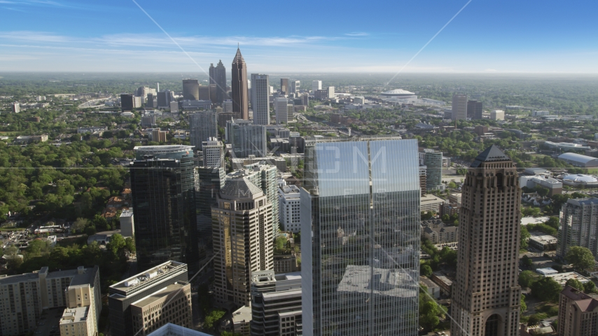 Midtown skyscrapers with more skyscrapers in the distance, Atlanta, Georgia Aerial Stock Photo AX38_067.0000313F | Axiom Images
