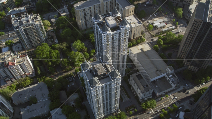 Tilt down on a condominium complex, Midtown Atlanta, Georgia Aerial Stock Photos | AX38_068.0000082F