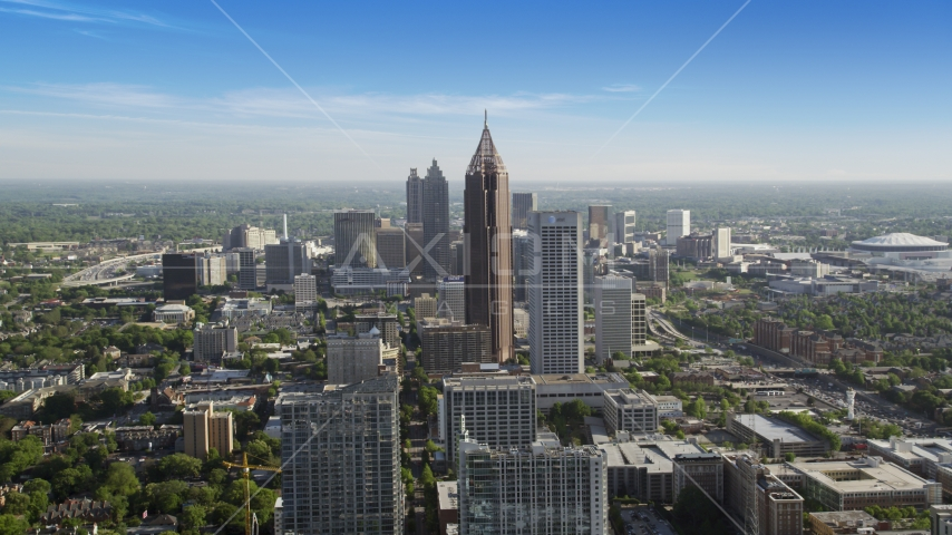 Bank of America Plaza towering over city buildings, Midtown Atlanta, Georgia  Aerial Stock Photos | AX38_069.0000036F